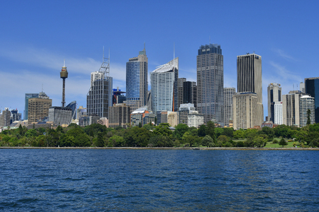 Sydney, NSW, Australia - October 28, 2017: Skyline with office buildings and Sydney Tower aka Centrepoint Tower, Australia, Sydney, Skyline with different buildings, skyscrapers, Sydney Tower aka Centrepoint Tower, view from Farm Cove