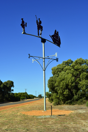 Cervantes, WA, Australia - November 23, 2017: Wind wheel with figures of Don Quixote and Sancho Pansa in the city on Indian Ocean in Western Australia, reference to Spain and writer Miguel de Cervantes Editorial