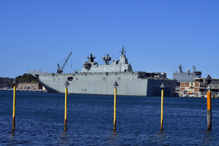 Sydney, NSW, Australia - October 31, 2017: HMAS Canberra in Wooloomooloo wharf, a helicopter carrier of the Australian navy