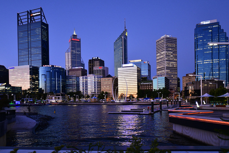 Perth, WA, Australia - November 30, 2017: Elizabeth Quay and Esplanade with dirfferent buildings at evening