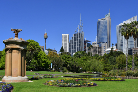 Sydney, NSW, Australia - October 28, 2017: Choragic monument of Lysicrates at the Royal Botanic Garden in front of the skyline with office buildings, skyscrapers and Centrepoint tower