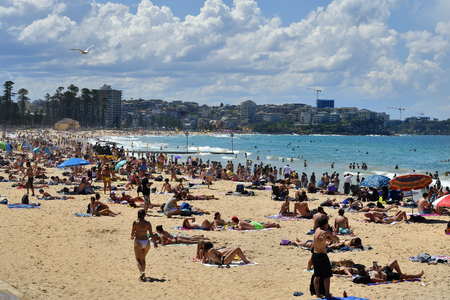 Sydney, NSW, Australia - October 29, 2017: Unidentified people enjoy a sunny day on Manly beach
