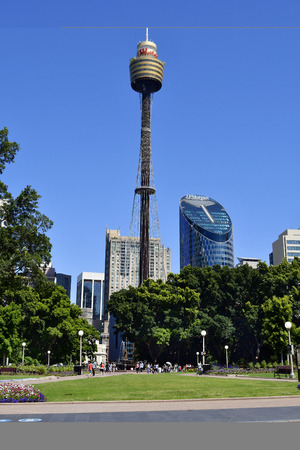 Sydney, NSW, Australia - October 29, 2017: Unidentified people in Hyde park with Archibald fountain, Sydney tower and skysraper behind