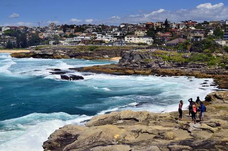 Sydney, NSW, Australia - October 31,2017: Unidentified people by walk along the coast between Tamarama beach and Bondi beach with stormy sea