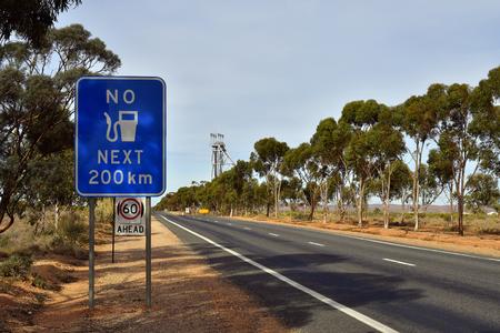 Australia, sign for next petrol station far away from Broken Hill city