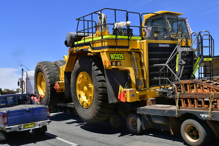 Broken Hill, Victoria, Australia - November 10, 2017: Abnormal wide load on truck usually named road train carry a mining vehicle in the frontier city in Australians outback