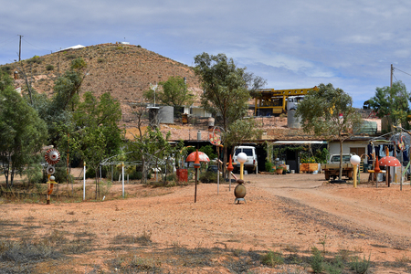 Coober Pedy, SA, Australia - November 13, 2017: Mining equipment and decoration at home built into rock in the opal village in South Australia