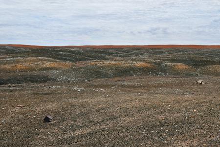 Australia, Coober Pedy, grim landscape named Moon Plaine, a vast expanse of rocky plains unlike anywhere else, sometimes used as film location.
