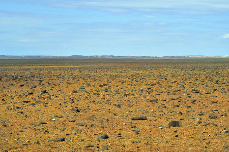 Australia, Coober Pedy, grim landscape named Moon Plane, a vast expanse of rocky plains unlike anywhere else, sometimes used as film location.