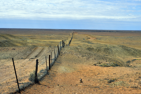 Australia, dog fence aka dingo fence, 5300 km long fence to protect pastures for sheeps and cattles Stock Photo
