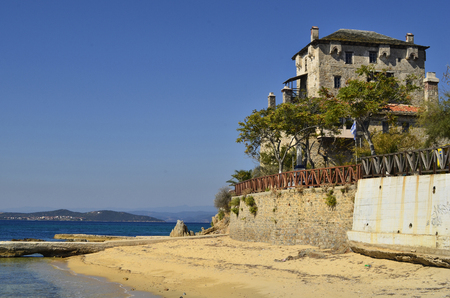 Ouranoupoli, Greece - September 29, 2011: Medieval Prosphorios-Tower in the village on Athos peninsula on Aegean sea Editorial