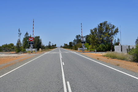 Australia, railway crossing and spread line on Brand  highway in Western Australia