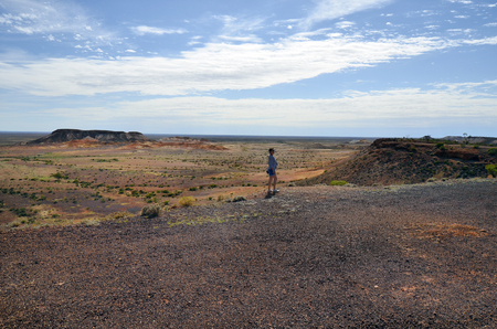 Coober Pedy, SA, Australia - November 13, 2017: Unidentified woman on breakout at the breakaway national park