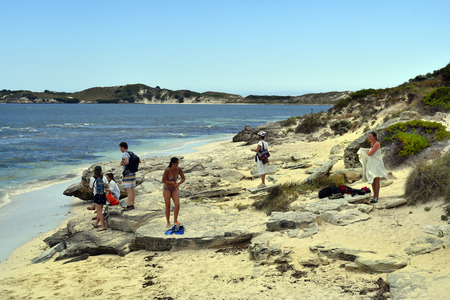 Perth, WA, Australia - November 27, 2017: Unidentified people on beach in Porpoise Bay on Rottnest Island Stock Photo - 100571728