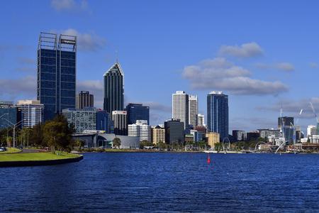Perth, WA, Australia - November 27, 2017: Skyline from Perth on Swan river with different buildings, Spanda sculpture and Elizabeth bridge