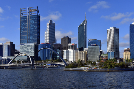 Perth, WA, Australia - November 27, 2017: Skyline from Perth on Swan river with different buildings, Spanda sculpture and Elizabeth bridge