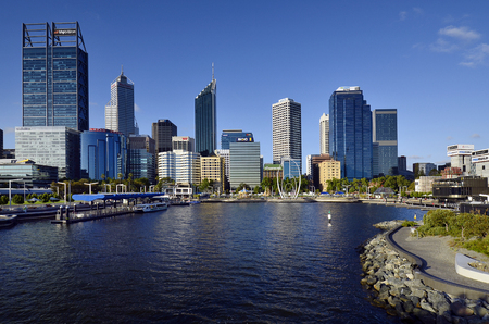 Perth, WA, Australia - November 27, 2017: Skyline from Perth on Swan river with different buildings and Spanda sculpture on Elizabeth Quay esplanade 報道画像