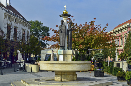 Sopron, Hungary - October 31, 2014: Religous sculpture, Restaurant and buildings in the historical part of the city