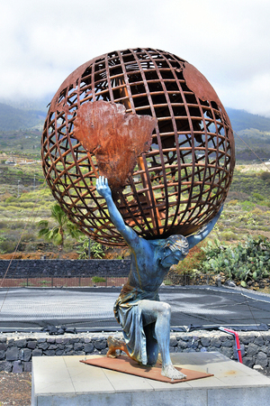 Guimar, Canary Islands, Spain - April 06, 2018: Sculpture with Titan Atlas carries the world on his shoulders, historic figure from Greek mythology