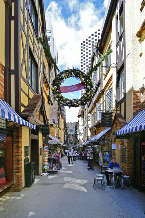 Perth, WA, Australia - November 28, 2017: Unidentified people inside London Court, preferred arcade for shopping and dining, decorated with Advent wreath