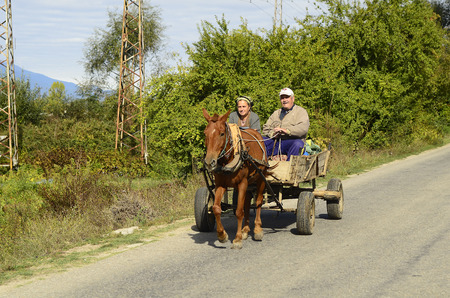 Rila, Bulgaria - October 02, 2010: Unidentified couple of peasants on traditional horse cart in the rural area of Rily valley