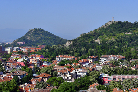 Bulgaria, Plovdiv, cityview from Nebet Hill with different buildings and statue of Alyosha on Liberators hill