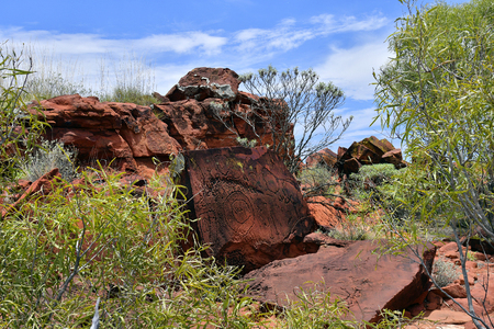 Australia, NT, public Ewaninga Conservation Reserve, area with prehistoric engravings and Aborigines historical site, rock with lichens Stock Photo