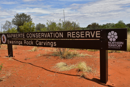 Alice Springs, NT, Australia - November 19, 2017: Sign for public historical Ewaninga Conservation Reserve with prehistoric gracings and petroglyphs Editorial