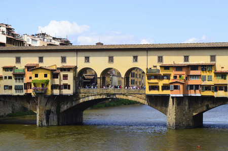 Florence, Italy - June 13, 2012: Medieval old bridge - Ponte Vecchio - a stone closed-spandrel segmental arch bridge over Arno River, one of the landmarks in the Unesco World Heritage site in Tuscany Editoriali