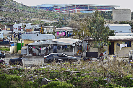 Heraklion, Greece - December 22, 2013: Unidentified people in poorly looking Roma settlement, situated at suburban of Heraklion on Crete island