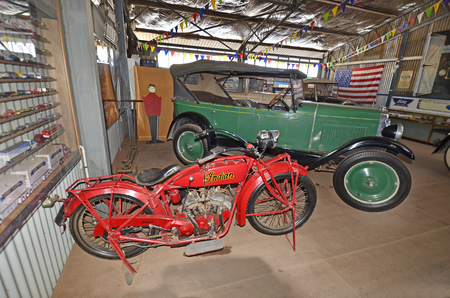 Alice Springs, NT, Australia - November 20, 2017: Vintage cars in The Ghan museum, Chevrolet national tourer and Indian Scout bike