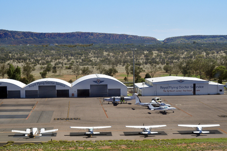 Alice Springs, NT, Australia - November 21, 2017: Aircrafts and hangars of Royal Flying Doctor Service on Alice Springs airport in Northern Territory
