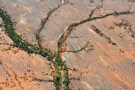 Australia, NT, aerial view over outback landscape with dry river bed around Alice Springs Stock Photo