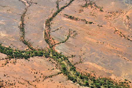 Australia, NT, aerial view over outback landscape with dry river beds around Alice Springs Stock Photo