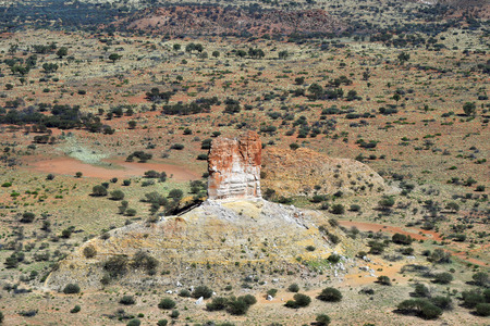 Australia, NT, aerial view of remarkable Chambers Pillar rock in Outback of Simpson desert