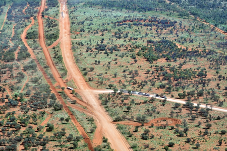 Australia, NT, trucks and equipment for road construction on Maryvale road south of Alice Springs