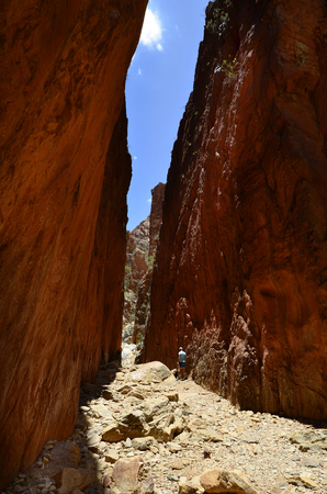 Australia, NT, woman walking through remarkable Standley Chasm in McDonnell Range national park Stock Photo