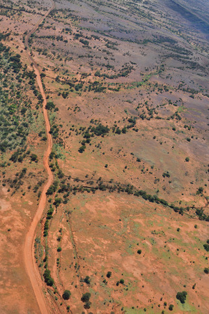 Australia, NT, aerial view over outback landscape and Chambers Pillar road near Alice Springs Stock Photo