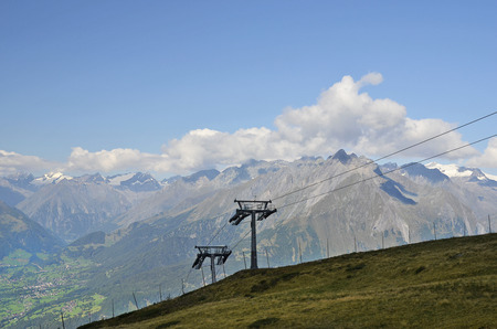 Austria, Tirol, cable car to Goldried mountain with view to Austrian Alps and village of Matrei in East-Tyrol Stock Photo