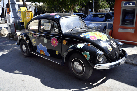 Matala, Greece - October 07, 2018: Funny decorated Beetle car, a reminiscence to former Hippie lifestyle in the village on the coast of South Crete