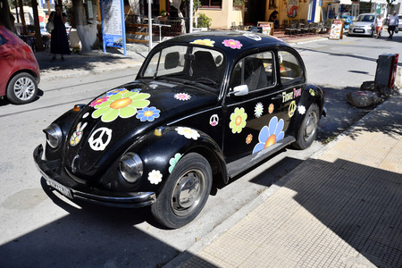 Matala, Greece - October 07, 2018: Beetle car as reminiscence to former flower power generation in the village in the south of Crete Editorial