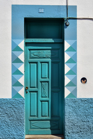Tenerife, Canary Islands, Spain - April 03, 2018: Home with colorful facade and funny mouse painting in La Ranilla district in Puerto de la Cruz Editorial
