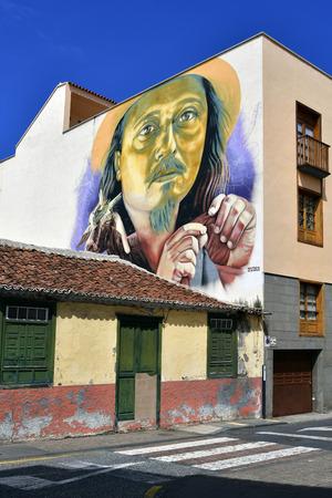 Tenerife, Canary Islands, Spain - April 03, 2018: Building with painted facade in La Ranilla district in Puerto de la Cruz