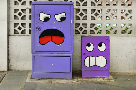 Tenerife, Canary Islands, Spain - April 01, 2018:  Painted boxes for telefon and electricity in a street of Puerto de la Cruz Editorial