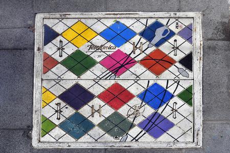 Tenerife, Canary Islands, Spain - April 03, 2018:  Painted manhole cover in a street of Puerto de la Cruz