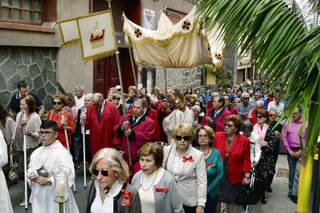 Tenerife, Canary Islands, Spain - April 01, 2018: Unidentified people and priest with monstrance by religious Easter procession in the streets of Puerto de la Cruz
