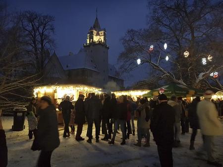 Ebreichsdorf, Austria - December 01, 2018: Unidentified people on Christmas market with castle Ebreichsdorf behind Editorial