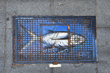 Tenerife, Canary Islands, Spain - April 01, 2018:  Painted manhole cover in a street of Puerto de la Cruz