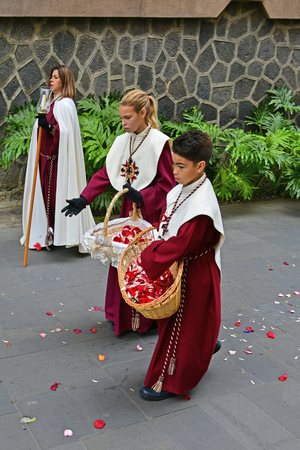 Tenerife, Canary Islands, Spain - April 01, 2018: Unidentified people in traditional costume by religious Easter procession in the streets of Puerto de la Cruz