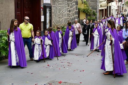 Tenerife, Canary Islands, Spain - April 01, 2018: Unidentified people by traditional religious Easter procession in the streets of Puerto de la Cruz